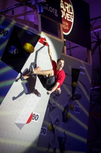"""Ruben topping his super-final boulder above water in the """"Schwimming Opera"""" of Wuppertal in the HardMoves Boulderleague event"""